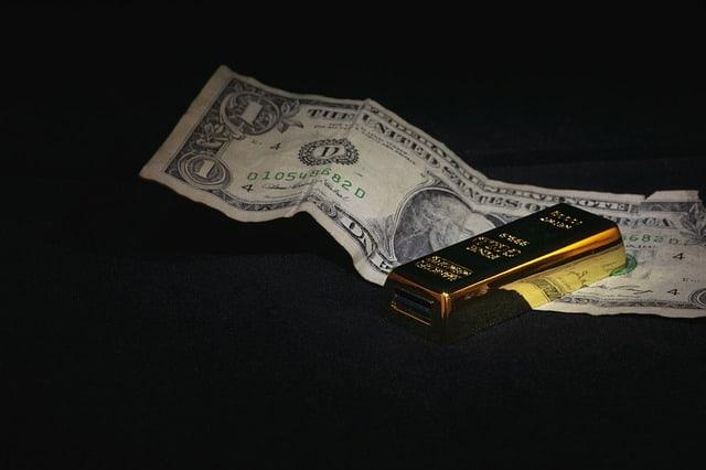 banknot jednodolarowy ze sztabką złota